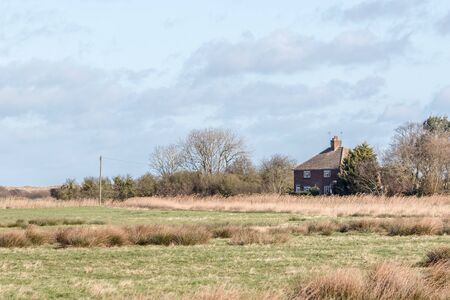 Isolation and seclusion. Living in the country. Secluded house isolated in the English countryside. Rural scene from Norfolk UK. Remote lonely home cut off from civilisation.