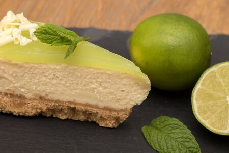 Lime and mint cheesecake dessert close-up. Delicious sweet food preparation with ingredients.