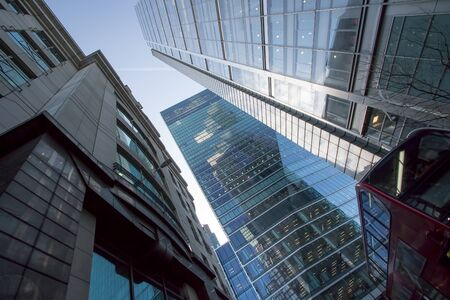 London city center skyscraper building. Business architecture UK. Tower blocks rising above central London bus. Imagens