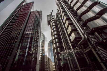 Dystopian metropolis. Film noir gothic style industrial architecture landscape image . Dark futuristic inner city London lightly defocussed for post-apocalyptic authoritarian comic book surrealism.