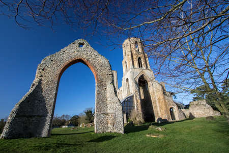 Ancient church ruins. Wymnondham abbey Norfolk England. Historic religious architecture. Remains of an old Benedictine monastry. Beautiful priory restoration in church grounds. Editorial