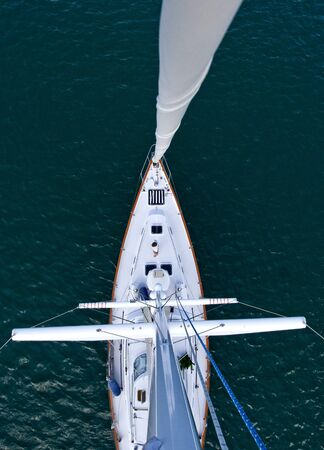 Looking down the mast of a tall modern sailboat
