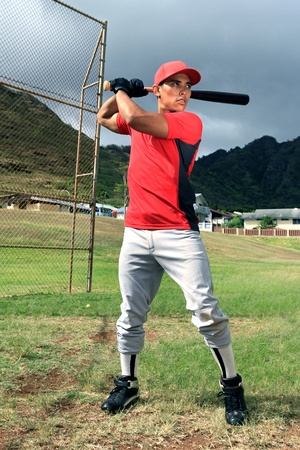 Baseball player stands at bat