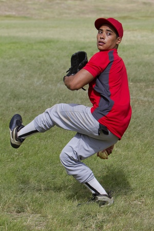 Baseball player mid-pitch