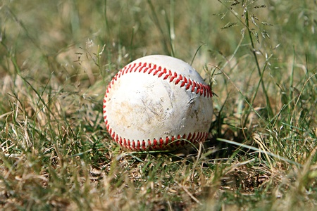 Old baseball in the outfield Stock Photo - 11562267