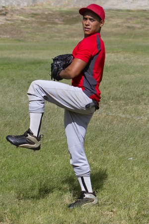 Baseball player stands ready to pitch