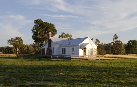 Old farm house in warm evening light Stock Photo