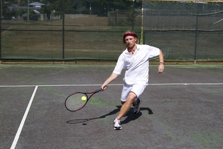 A blonde male tennis player takes a step into a solid forehand return swing