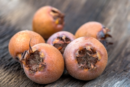 Healthy Medlars on the old wooden table