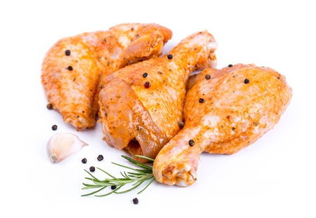 raw chicken: Raw chicken legs and wings Delicious marinated chicken legs and wings, with pepper, rosemary, parsley and garlic, isolated on white Stock Photo