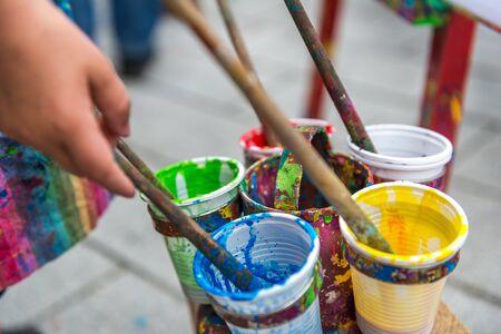 handcarves: A young boy paints a picture