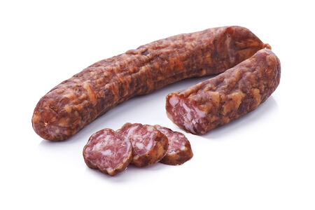 Sliced dried salami isolated on white background Stock Photo
