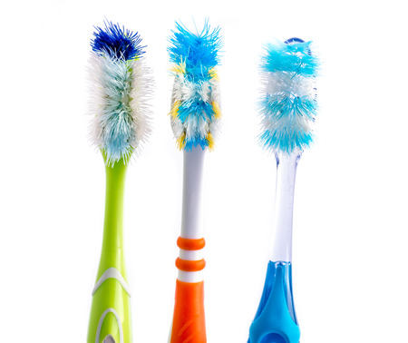 Old used colorful toothbrushes isolated on white background Stok Fotoğraf