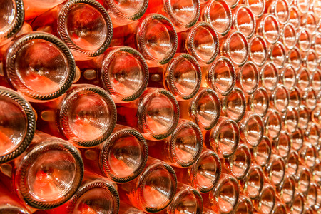 A row of champagne bottles - Wine cellar Bottles of wine stocked in a wine cellar  Stock Photo
