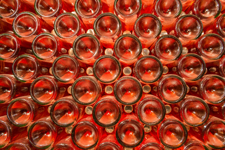 stocked: A row of champagne bottles - Wine cellar Bottles of wine stocked in a wine cellar  Stock Photo