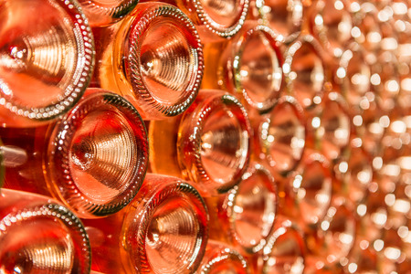 A row of champagne bottles - Wine cellar Bottles of wine stocked in a wine cellar  photo