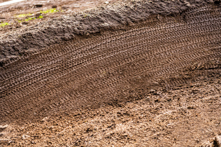 scrambling: Mountain Bike Tracks in background mud