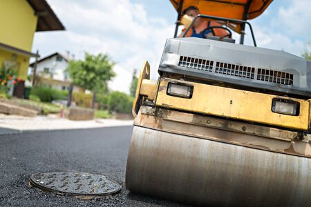 construction vibroroller: Compactor roller at asphalting work. Stock Photo