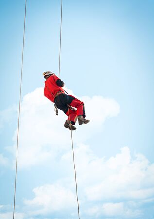 rescue: Member of height rescue squad, during a fire training exercise