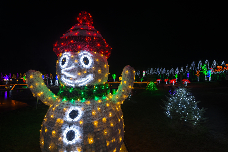 Glowing Christmas snowman and Christmas tree in background with space for text