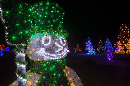 biblical events: Glowing Christmas snowman and Christmas tree in background with space for text