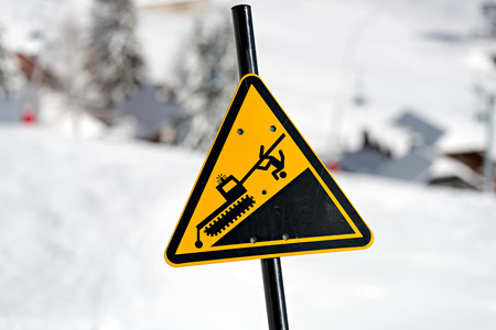 Ski Area: Danger! Snowcat sign on a Ski Area