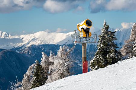 machinery machine: Modern snow cannon on a ski slope Stock Photo