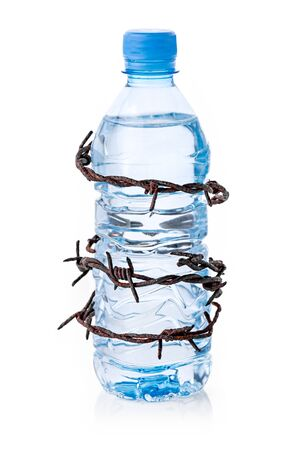 Barbed wire surrounding bottle of water isolated on white background