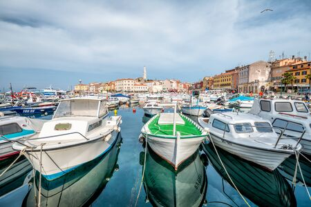ROVINJ, CROATIA - APRIL 2, 2016: Panoramic view on old town Rovinj from harbor. Istria peninsula, Croatia.