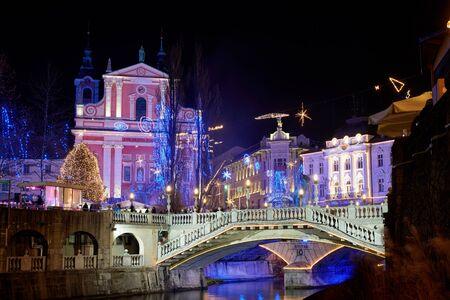 brige: Christmas time decorated Ljubljana