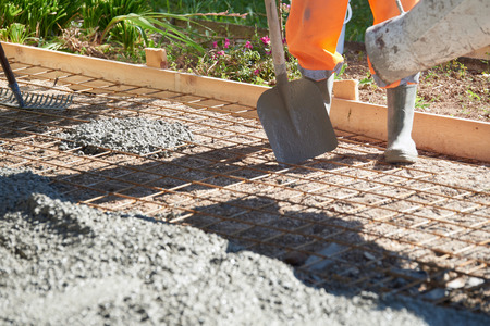 concreting: Concrete pouring during commercial concreting floors of building