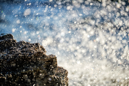 rocks water: Water splashing - crystal clear sea water beating against the rocks and cliffs. Stock Photo