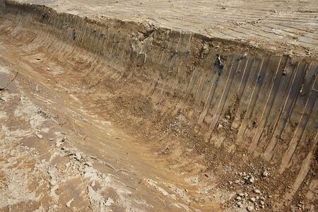 A channel for the drainage of the water that was dug with a bulldozer Stock Photo