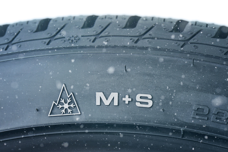 Close up of new winter tire - profile M+S Stockfoto