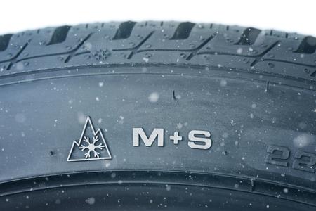 Close up of new winter tire - profile M+S Archivio Fotografico