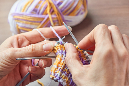 Young Woman Knitting - Knitting inspiration is at your fingertips