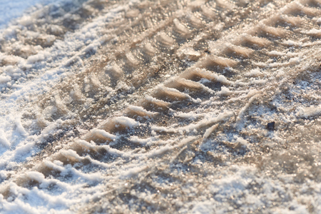 Tire tracks in the frozen snow - ice Stock Photo