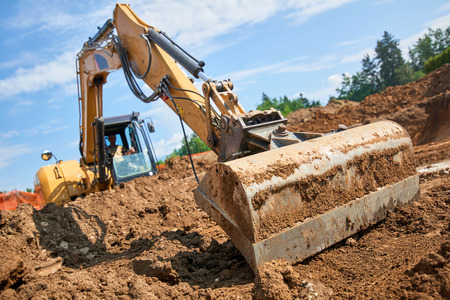 Excavator at Construction Site - digging foundations for house