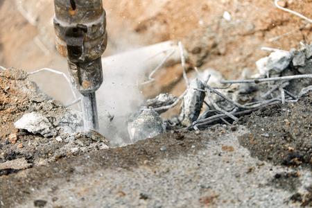 Close up of jackhammer - worker man using a jackhammer to drill into concrete Standard-Bild - 104780560
