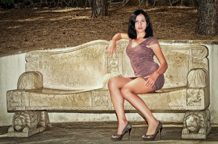 a beautiful girl sits on a bench in a park Stock Photo - 15045560