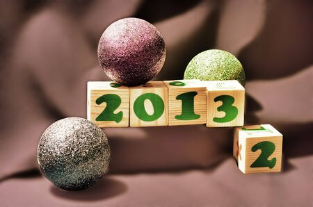 Happy new year 2013 blocks on a brown background