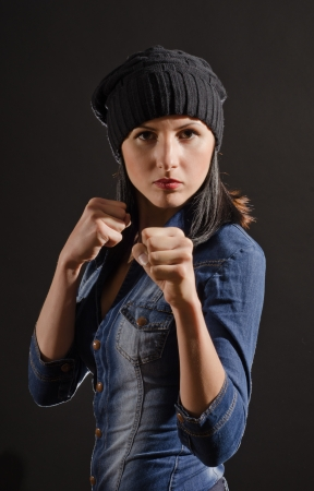 punching: Portrait of young woman ready to fight