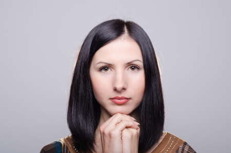 Young beautiful woman prays