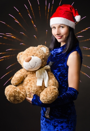 snow maiden presents a toy bear in a gift Stock Photo - 16756882