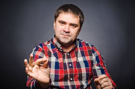 gesticulating: Portrait of young man of gesticulating by hands Stock Photo