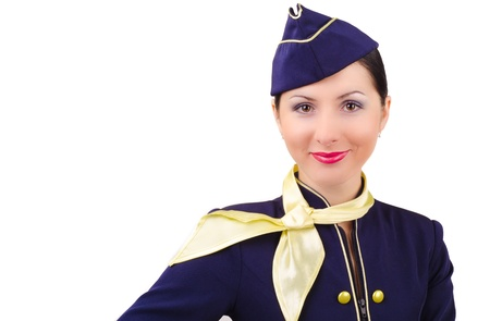 Beautiful young smiling stewardess in uniform isolated Stock Photo - 17425261