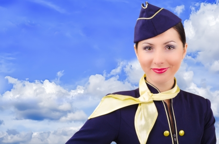 Beautiful young smiling stewardess on a background sky Stock Photo - 17425264