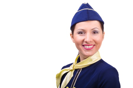 Beautiful young  smiling stewardess isolated on a white background Stock Photo