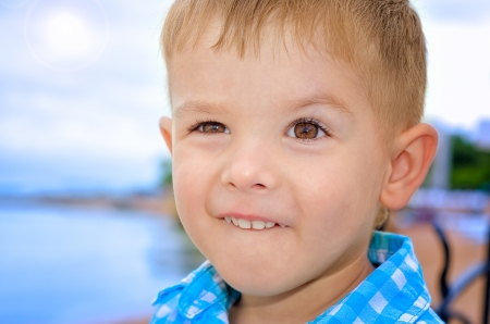 Funny portrait of a smiling little boy