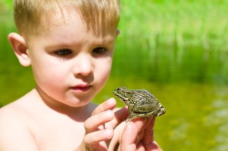acquaintance:  Acquaintance a little boy with a frog